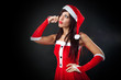 Beautiful girl wearing santa claus clothes thinking