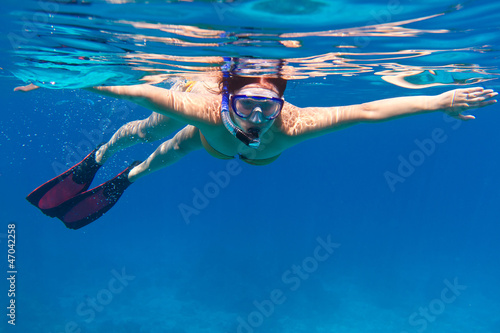 Young women at snorkeling in the sea