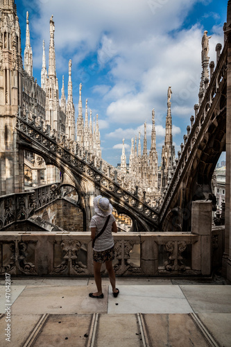 A tourist admires the spiers of Milan Cathedral Duomo.