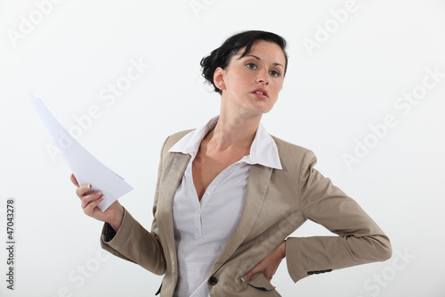 woman in a suit holding documents