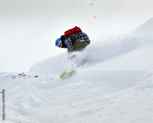 Snowboarder moving down