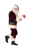 Santa Claus walky by with present poster