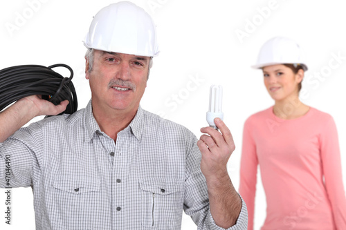 young female electrician with tutor
