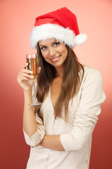 beautiful young woman with glass of champagne, on red