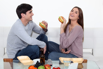 Couple eating hamburgers