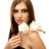 portrait of sexy young woman with white orchid flower, isolated