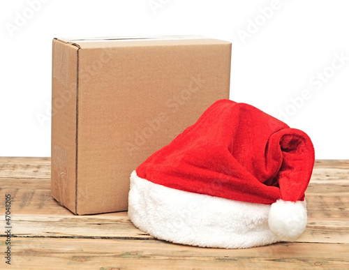 santa hat with brown cardboard box over white
