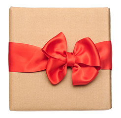 red ribbon bow over recycled nature paper cardboard. holidays ba