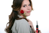 woman holding rose screwdriver in hand