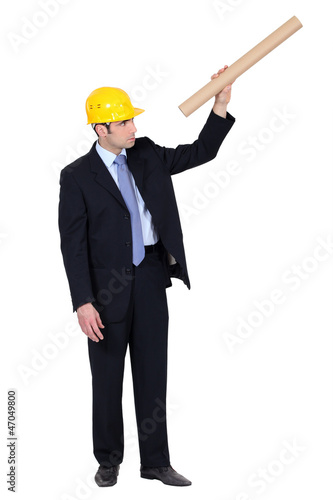 Architect looking through carboard tube