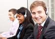 canvas print picture - team in callcenter mit headset beim telefonieren