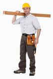 A carpenter carrying planks.