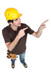 Builder pointing with both hands