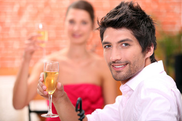 Couple on a date drinking champagne.