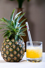 fresh cold pineapple juice extracted in pineapple fruit