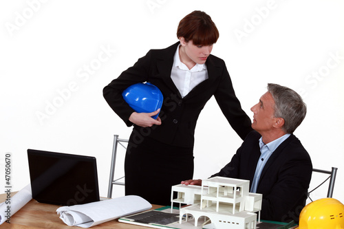 real estate businessman and businesswoman in their office