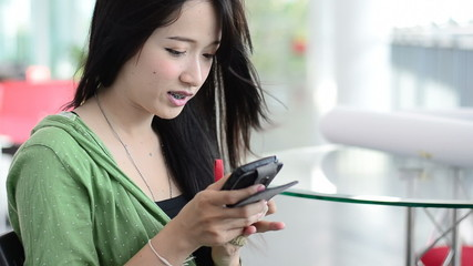 Close up of beautiful young woman using a mobile phone