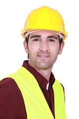 Builder wearing high-vis vest