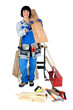 Tradeswoman posing with her tools and building supplies