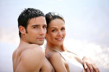 Couple in swimsuit at the oceanside