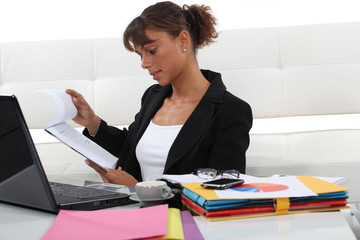 Woman swamped with paperwork