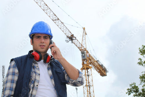 A foreman on his phone onsite.