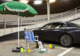 beach umbrella with deckchairs in a parking garage