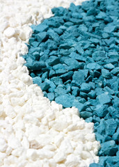 A closeup of colorful white and blue stones sand