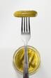 Pickled gherkin on a fork