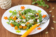 Salad with pumpkin, feta and arugula on a plate