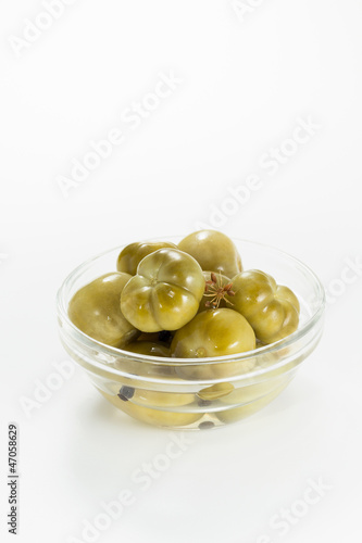 Pickled green tomatoes in bowl