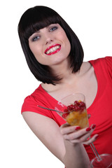 Attractive woman drinking a cocktail