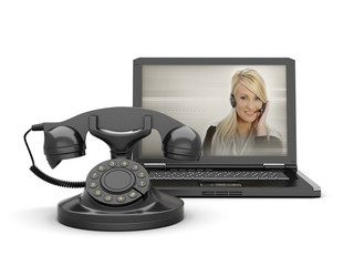 Woman on laptop screen and old rotary phone