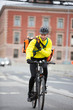 Male Cyclist With Courier Bag Using Walkie-Talkie