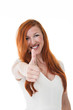 Attractive redhead gives the thumbs up