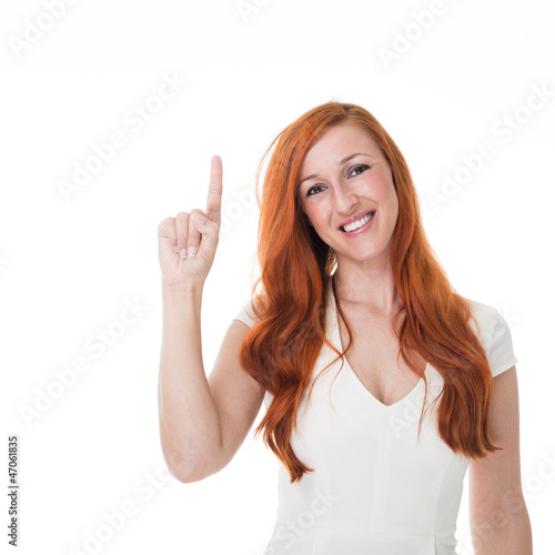 Beautiful redhead pointing upwards