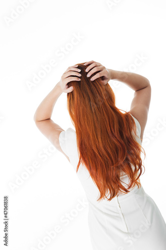 Rear view of red haired woman