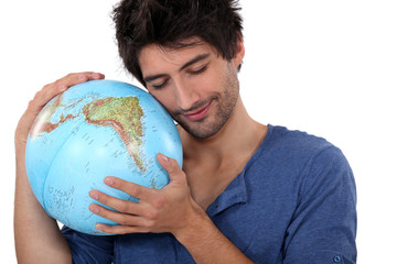 Man hugging a globe