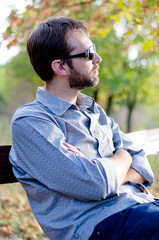 Man sitting thinking in sunshine
