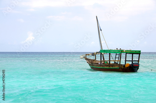 Wooden boat floating on the turquoise sea