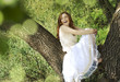 beautiful girl in spring green garden