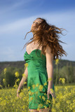 beautiful red-haired girl in a green field