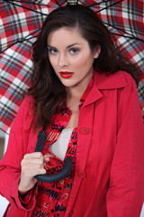 elegant woman under her umbrella