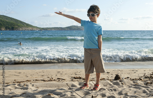 portrait of little boy on the beach