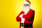 Saint Nick posing confidently against yellow background poster