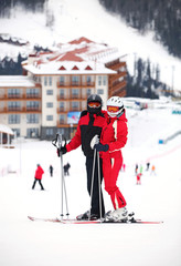 Young couple standing on a ski slope
