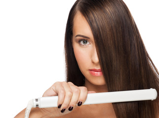 Woman with hair straightening irons