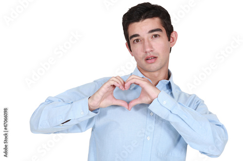 Man making a heart with his hands