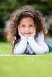 Little girl studying outdoors