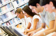 Students researching at the library